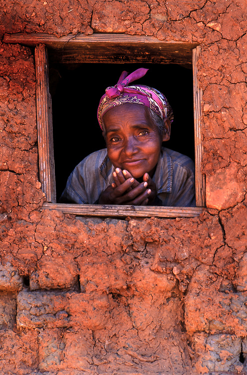 Portrait of a local woman in her mud home in the Fianarantsua Highlands Poverty is rife in the Fianarantsua Highlands of Madagascar