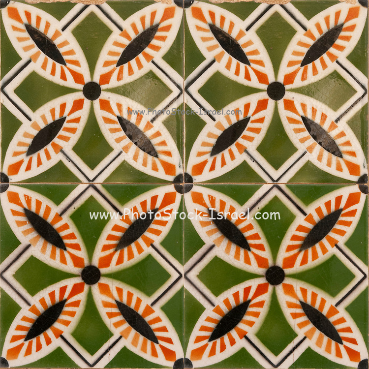 Traditional orange and green Portuguese seamless ceramic tiles used to decorate the outside walls of houses and buildings. Photographed in Portugal