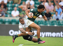 South Africa's Stedman Gans breaks through to score a try against Fiji during day two of the HSBC London Sevens at Twickenham Stadium, London.