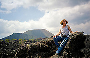 Liana Welty poses in the lava fields of Volcan Paricutin (Parikutin Volcano) outside Angahuan in Michoacan, Mexico.
