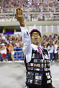 Men dressed as early 20th Century press photographers, dancing for Salgueiro Samba School doing the final practice performance of their Carnival procession in the Sambadrome, Rio de Janeiro, Brazil
