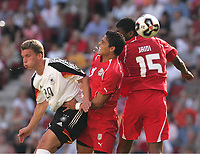 Fotball, 18. juni 2005, Confederations Cup Tunisia - Tyskland, <br /> v.l. Lukas Podolski GER, Wissem Abdi, Radhi Jaidi<br /> Norway only