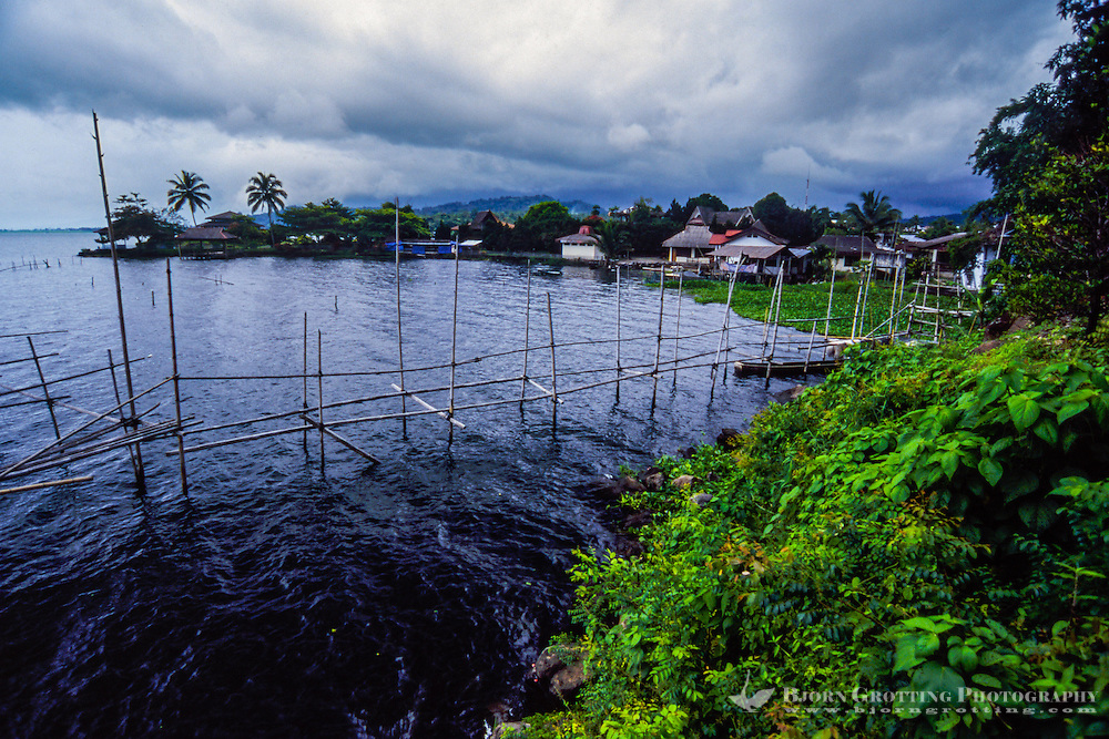 Indonesia, Sulawesi, Tondano. Lake Tondano is a large lake along the side of an ancient volcanic caldera. The shallow lake is a popular resort area.