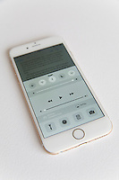 Gold and white Apple iPhone 6 settings screen against a white background