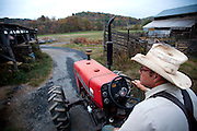 After moving the portable henhouses to a fresh pasture with his tractor at dawn, Virginia farmer Joel Salatin heads back to the barns to help rotate cattle from one pasture to another. (From the book What I Eat: Around the World in 80 Diets.) The caloric value of his day's worth of food on a day in the month of October was 3,900 kcals. He is 50; 5 feet 11 inches and 198 pounds. Much of his daily fare is from his own farm, including applesauce and apple cider canned by his wife, Teresa, who fills the basement larder with the bounty of their farm each year.