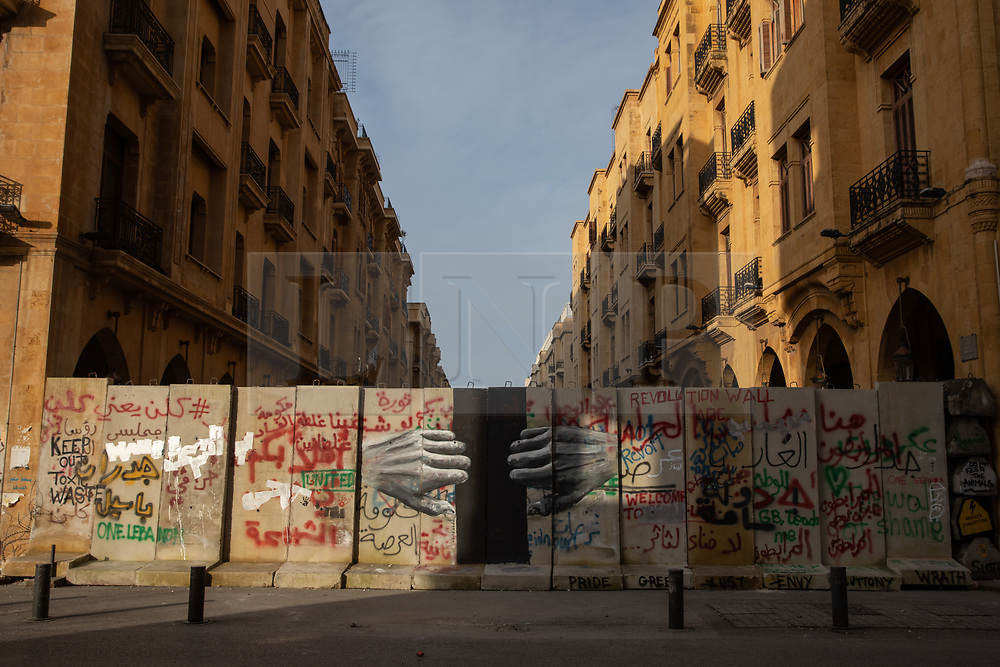© Licensed to London News Pictures. 27/01/2020. Beirut, Lebanon. Graffiti artwork on security walls around the government buildings in Downtown Beirut, as the government votes on the 2020 budget. Anti government demonstrators have been campaigning against government corruption and economic crisis for 103 days in Lebanon. Photo credit : Tom Nicholson/LNP