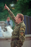 Saint Petersburg, Russia, 27/07/002..The mid-summer White Nights period when the sun sets only briefly is a time of festivals & entertainment. A drunk soldier cheers a rock group at the Neva Delta Blues festival in a city centre park..