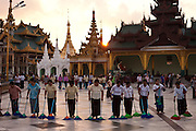 In the end of the day an army of cleaning staff sweep the entire grounds of the  Shwedagon Pagoda, the Golden Pagoda is the most sacret pagoda in Myanmar, Yangon, Burma.<br /> Note: These images are not distributed or sold in Portugal