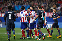 Atletico de Madrid´s Raul Garcia argues with Olympiacos´s N´Dinga during Champions League soccer match between Atletico de Madrid and Olympiacos at Vicente Calderon stadium in Madrid, Spain. November 26, 2014. (ALTERPHOTOS/Victor Blanco)