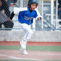 Navajo Pine Warriors eight grader Sedrick Laughlin (1) dashes out of the batters box to first base after making connection with the ball against the Wingate Bears during the Wingate Shash tournament at Ford Canyon Park in Gallup on Thursday.