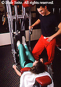 Health Spa, Nautilus Exercise, Fitness Club, PA Young Adult Couple Pose During Exercise Routine Young Adult Female Works Out,