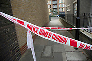 Crime scene where a male police officer was shot during a firearms operation in Scriven Street in the Haggerston area of Hackney. A specialist firearms unit and officers from Trident Area Crime Command, which is responsible for tackling gang crime, were conducting an operation in Scriven Street at the time of the shooting. Cordond off area where police were making enquiries.