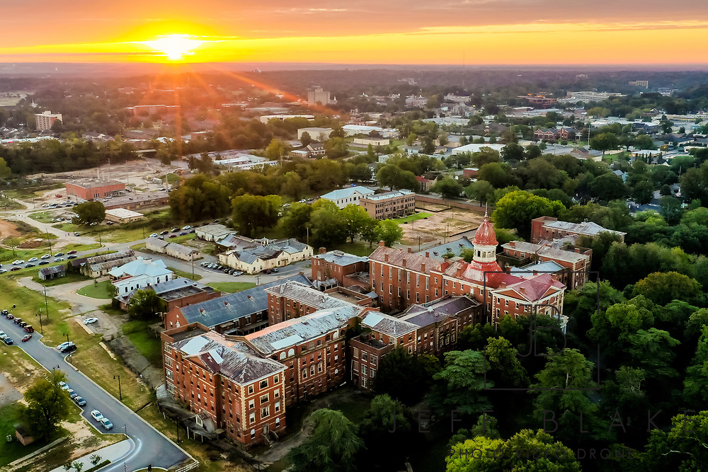 Aerial drone photo of sunrise over the Historic Babcock Building in the Bullstreet District in Columbia, SC. Photo © Jeff Blake Photo