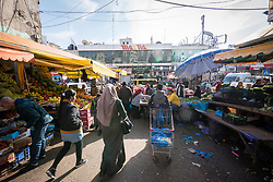 27 February 2020, Ramallah, Palestine: People go about their day at the fruit market in central Ramallah.