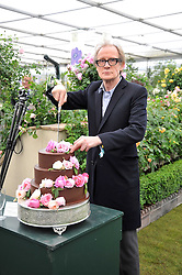 BILL NIGHY cuts a cake to celebrate the 40th anniversary of David Austin at the RHS Chelsea Flower Show 2009 held inthe gardens of the Royal Hospital Chelsea on 18th May 2009.