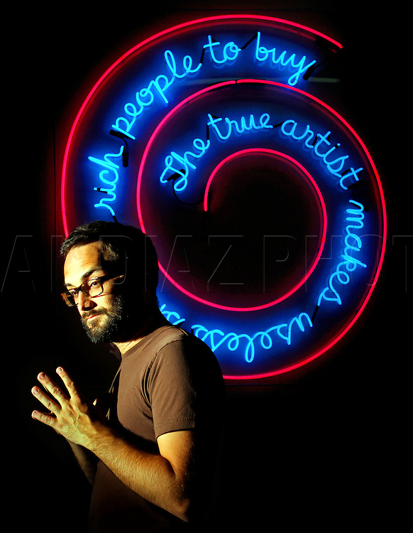 Artist Bert Rodriguez is part of a new generation of young artists who are staying in Miami and changing the cultural scene. He works with neon as part of his art creation.