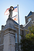 """Confederat statute at Sumner Courthouse. Vandalized Emmett Till Memorial sign. The sign has been replaced 4 times and is now a 500 lb. steel bullet proof sign placed at Graball Landin the site Emmett Till's body was pulled from the Tallahatchie River.<br /> As Patrick Weems, Executive Director of the Emmett Interpretive Center said,"""" Mississippi did not put this up a resilient and committed group of black and white local citizens in the poorest county in Mississippi put this historic marker back up. Yes the vandalism is awful but the resolve to continue telling the truth is the story."""" The sign had been vandalized 4 times and now is bulletproof. Photo©SuziAltman"""