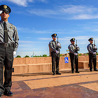 052915       Adron Gardner<br /> <br /> Gallup Police Officer Victor Rodriguez leads the honor guard salute during the Gallup Police Department Fallen Officer's Memorial at the McKinley County Courthouse in Gallup Friday.