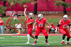 NORMAL, IL - October 06: Brady Davis delivers a pass protected by Garrett Hirsch and Gabe Megginson during a college football game between the ISU (Illinois State University) Redbirds and the Western Illinois Leathernecks on October 06 2018 at Hancock Stadium in Normal, IL. (Photo by Alan Look)