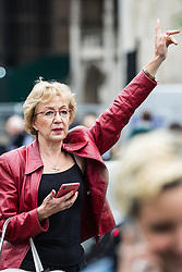 London, UK. 18 June, 2019. Andrea Leadsom MP, formerly Leader of the House of Commons, hails a taxi outside Parliament following the second round of voting for the leadership of the Conservative Party.  Andrea Leadsom was eliminated following the first round and has since given her backing to Boris Johnson.