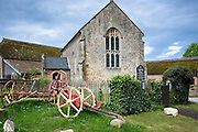 Lynch Medieval Chapel of Ease church and old farm implements at Selworthy in Exmoor National Park, Somerset, UK