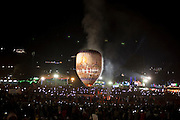 People watching the giant air ballon going up into the sky, Taunggyi Ballon Festival, in Taunggyi, Myanmar.<br />
