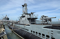 USS Pampanito, decomissioned Second World War II submarine, one of numerous tourist attactions at Fisherman's Wharf, San Francisco, California, USA. In the background is another popular attraction, the Liberty Ship, Jeremiah O'Brien, 201304131378<br /> <br /> Copyright Image from Victor Patterson, 54 Dorchester Park, Belfast, UK, BT9 6RJ<br /> <br /> Tel: +44 28 9066 1296<br /> Mob: +44 7802 353836<br /> Voicemail +44 20 8816 7153<br /> Skype: victorpattersonbelfast<br /> Email: victorpatterson@me.com<br /> Email: victorpatterson@ireland.com (back-up)<br /> <br /> IMPORTANT: If you wish to use this image or any other of my images please go to www.victorpatterson.com and click on the Terms & Conditions. Then contact me by email or phone with the reference number(s) of the image(s) concerned.