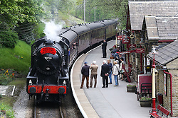© Licensed to London News Pictures. 13/05/2016. Haworth, UK. A War Department 2-8-0 engine pulls into Haworth train station on the Keithley and Worth Valley Railway Line during the annual 1940's weekend in Haworth, West Yorkshire.  Photo credit : Ian Hinchliffe/LNP