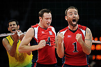 Beijing, China -- USA's Lloy Ball (1) celebrates a USA point alongside USA's David Lee (4) in the third game of the gold medal match with a dejected Brazil player Dante Amaral (18) hanging in the net as the USA men's volleyball team defeated Brazil for the gold medal at the Capital Gymnasium in Beijing, China. -- -- Photo by Jack Gruber, USA TODAY