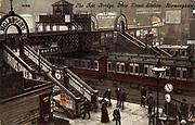 Footbridge linking platforms at Birmingham railway station, England. Postcard c1903. Colour-printed lithograph.