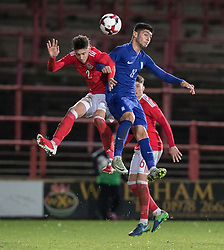 WREXHAM, WALES - Thursday, November 10, 2016: Wales' Cameron Coxe in action against Nikolaos Sampanidis of Greece during the UEFA European Under-19 Championship Qualifying Round Group 6 match at the Racecourse Ground. (Pic by Gavin Trafford/Propaganda)