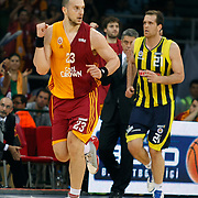 Galatasaray's Ermal KURTOGLU (L) and Fenerbahce Ulker's Oguz SAVAS (R) during their Turkish Basketball league Play Off Final third leg match Galatasaray between Fenerbahce Ulker at the Abdi Ipekci Arena in Istanbul Turkey on Thursday 09 June 2011. Photo by TURKPIX