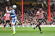Brentford Midfielder Moses Odubajo (2) takes a shot on goal but sends it way over the bar during the EFL Sky Bet Championship match between Brentford and Queens Park Rangers at Griffin Park, London, England on 2 March 2019.