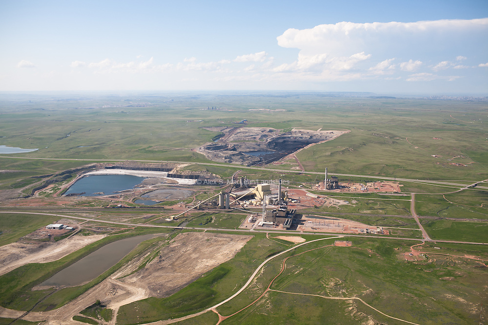 """Coal strip mining in the Powder River Basin. The Powder River Basin coal beds are shaped like elongated bowls and as mines expand from east to west in the Powder River Basin, they will be going """"down the sides of the bowl"""" in order to extract the coal."""