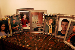 Photographs of the younger members of the Nashashibi family who have been educated overseas, Jerusalem, Israel, Feb. 12, 2005. The Nashashibi family are part of a Palestinian middle and upper class who are likely to have prominent roles in the developing peace process.