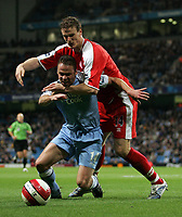 Photo: Paul Thomas.<br /> Manchester City v Middlesbrough. The Barclays Premiership. 30/10/2006.<br /> <br /> Robert Huth (R) holds back Man City player Paul Dickov.
