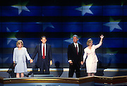 U.S President Bill Clinton with daughter Chelsea and wife Hillary Rodham Clinton wave to supporters along with Vice President Al Gore as confetti falls after they accepted the nomination for the democrat party at the 1996 Democratic National Convention August 29, 1996 in Chicago, IL.