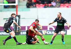 Scarlets' Gareth Davies is tackled by Glasgow Warriors' Ali Price<br /> <br /> Photographer Simon King/Replay Images<br /> <br /> Guinness PRO14 Round 19 - Scarlets v Glasgow Warriors - Saturday 7th April 2018 - Parc Y Scarlets - Llanelli<br /> <br /> World Copyright © Replay Images . All rights reserved. info@replayimages.co.uk - http://replayimages.co.uk