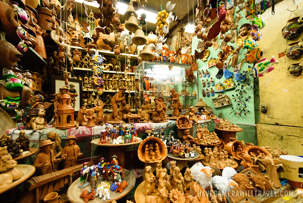 Clay figurines for sale at a shop inside the bustling Mercado Central in the center of Guatemala City near Parque Central.