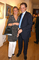 EVY & EMILY HAMBRO at an exhibition of art by Sam Sopwith held at 27 Cork Street, London W1 on 23rd May 2006.<br /><br />NON EXCLUSIVE - WORLD RIGHTS