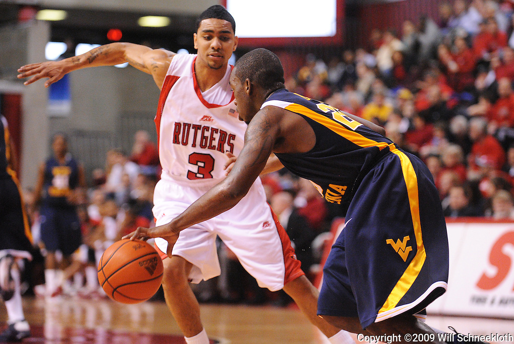 Feb 22, 2009; Piscataway, NJ, USA; Rutgers guard Mike Rosario (3) pressures West Virginia guard Darryl Bryant (25) during the first half of Rutgers' 74-56 loss to West Virginia at the Louis Brown Athletic Center.