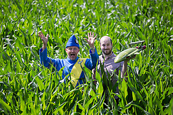 © Licensed to London News Pictures. 09/07/2015. York, UK. Picture shows farmer Tom Percy & Jamie Anderson. Farmer Tom Percy has carved a giant image of Thunderbird 2 out of an 18 acre field of Maze to celebrate 50 years of Thunderbirds (1965-2015). Jamie Anderson son of Thunderbirds creator Gerry Anderson was at the maze today to help Tom launch this years master piece. Photo credit : Andrew McCaren/LNP