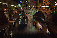 """Meganebashi or Spectacles Bridge, over the Nakashima River was built in Nagasaki in 1634.  Said to be the oldest stone arch bridge in Japan and has been designated as an Important Cultural Property of Japan. It received the nickname """"Spectacles Bridge"""" because its two arches and their reflection in the water create the image of a pair of spectacles."""