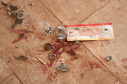 © under license to London News Pictures. 23/02/2011. Blood and broken glass lies next to an old boarding pass at Lubrique Aiport in Lubrique, Libya where 600 mercenaries loyal to Gadaffi fought the opposition in a three day battle. Photo credit should read Michael Graae/London News Pictures