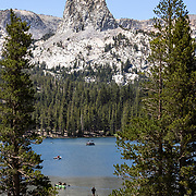 Crystal Crag, an imposing and rugged slab of granite, looms large over the lakes in Mammoth Lakes, CA.