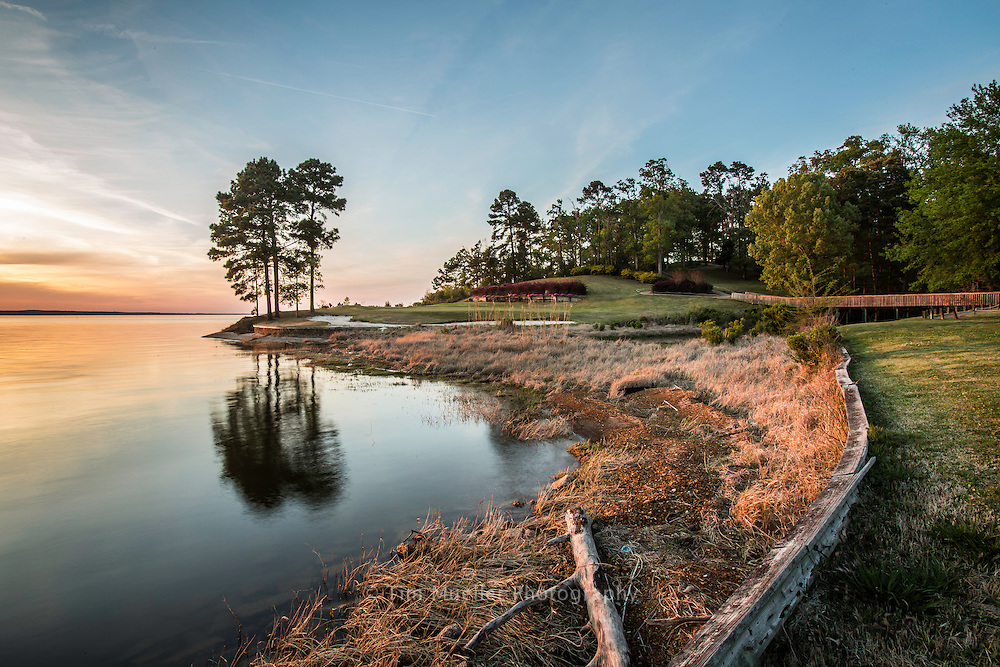 Sunset near the 17th-hole at Cypress Bend Golf Resort and Conference Center. Toledo Bend Forest Scenic Byway on Louisiana Highway 191 travels beside Toledo Bend Reservoir. The southern end of of the 76-mile byway starts at the reservoir dam, goes north through Sabine Parish and ends 20-miles into DeSoto Parish at Logansport and Hwy 84.