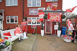 Emily Farley outside her home in Higham Square, Liverpool, which is decked out in Liverpool Football Club flags, ahead of the UEFA Champions League final.