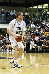 29 January 2011: Ryan Connolly during an NCAA basketball game between the Carthage Reds and the Illinois Wesleyan Titans at Shirk Center in Bloomington Illinois.