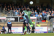 Tom Elliott of AFC Wimbledon jumps over Aaron Pierre of Wycombe Wanderers to head the ball. Skybet football league two match, Wycombe Wanderers  v AFC Wimbledon at Adams Park  in High Wycombe, Buckinghamshire on Saturday 2nd April 2016.<br /> pic by John Patrick Fletcher, Andrew Orchard sports photography.