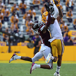 Sep 26, 2020; Baton Rouge, Louisiana, USA; LSU Tigers cornerback Eli Ricks (1) intercepts a pass over Mississippi State Bulldogs wide receiver JaVonta Payton (0) during the second half at Tiger Stadium. Mandatory Credit: Derick E. Hingle-USA TODAY Sports